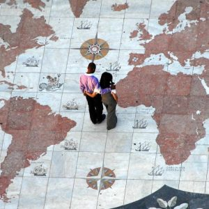 A couple watching the map floor